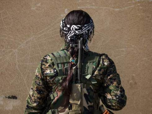 "20 year-old YPJ fighter Beritan Khabat from Derek, Syria. She joined the YPJ four years ago to protect her homeland and put an end to the suppression of women. ""I fought with ISIS in Jezza and Serikani.  Women of YPJ are not scared of ISIS.""  Newsha Tavakolian for TIME  Beritan believes that in her society women should be armed with guns and fight for their rights. She says that they have created a new idea for the men of the world. telling them that women too can be good fighters. ""I fought with ISIS in Jezza and Serikani. And the first time I heard the sound of bullets next to my ears was in Talala town, while I was fighting with ISIS for the first time. The first time I thought about facing ISIS, my whole body was shivering and the whole thing seemed more like a joke to me. But when I thought deeply, I realized that I was going to fight with a radical group, and this empowered me so much that all my fears faded away. Women of YPJ are not scared of ISIS""."